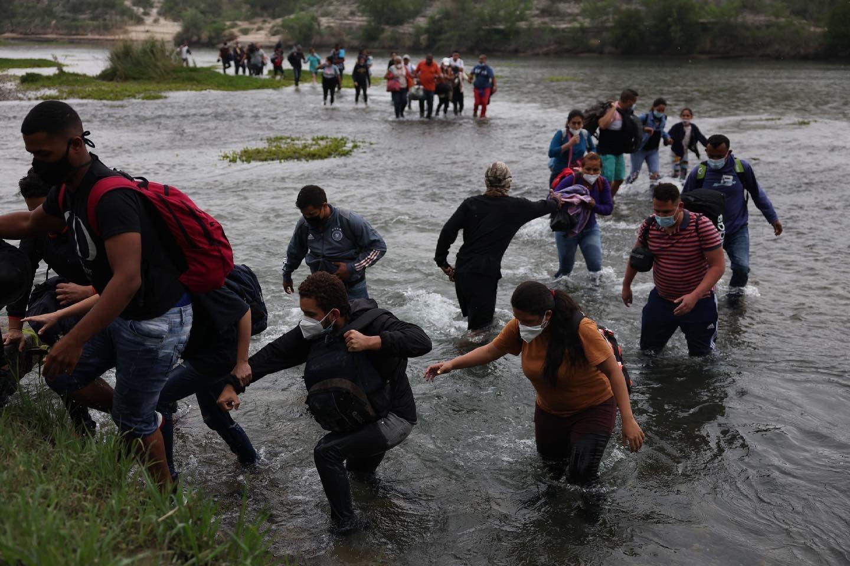 Immigrants Crossing River