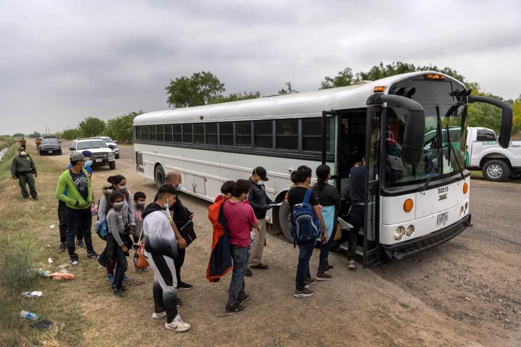 Immigrants Entering Bus